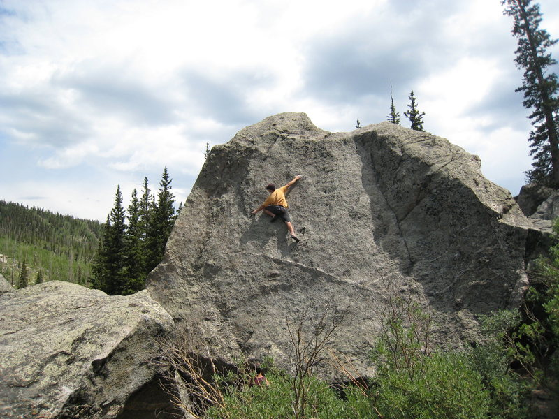 Beginning the crux section of Canvas.  From here, stand up on the left foot, and hit the diagonal rail directly above the climber's head.  Traverse up & right.