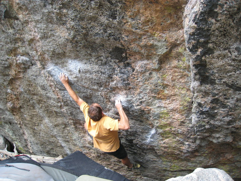 The shouldery crux move of the Dali SDS.  The problem begins matched on the chalked sidepull down & right of the climber's right elbow.