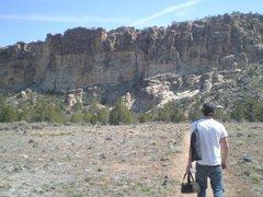 Pat walkin on trail towards crag