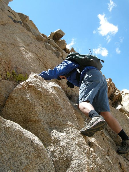 The first 4th class section is only about 5 ft., one move, to easier climbing.