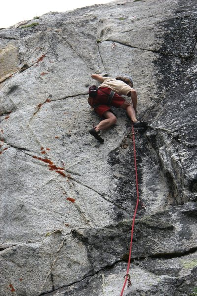 In the middle of the crux sequence on the first ascent of Anger Management 5.12a