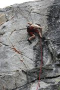 Rock Climbing Photo: In the middle of the crux sequence on the first as...