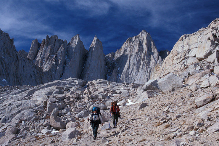 Jodi Levine and Arin Trook descend from Iceberg Lake after a trip up the Mountaineer's Route (January 1, 2001).