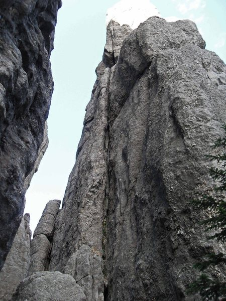 Looking up the squeeze chimney on Pitch 1 to the ledge above.