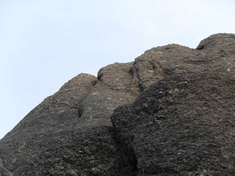 """Looking up the """"Standard Routes"""" on Moby Dick.  The short easy face climb is in the foreground, then the step across, then at the top you can see the left and right cracks.  I went up the right crack, but you could also make a delicate step left after the step across and then go up the right crack."""