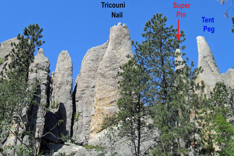 Looking at the Tricouni Nail, Super Pin, and Tent Peg from across the small gully to the east.  A climber can be seen just beneath the summit of the Nail.