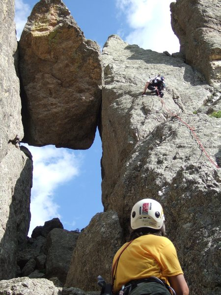 Lenore Sobota belaying Paul Huebner. The 1st anchors are just above and below the huge chockstone. (Photo by Anne Meyer)