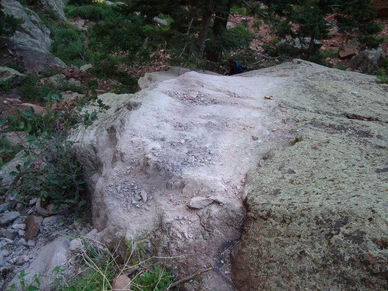 Impact spot showing pulverized rock dust ~50' <em>below</em> the base of Rewritten.  A large block must've nailed this slab and disintigrated.