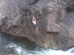 Rock Climbing Photo: Cale traversing to the start of Rapids Rock.