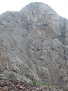 This route's located on the left side of this photo on grayish rock.  Route's located on the left leaning ramp (that's in the left half of this photo).  (There are two bolted routes which start on this ramp. It's the left route. Route runs close to left edge of ramp. When you're up close, the bolts are hard to miss.)