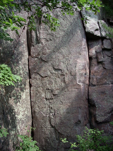 "The inside corner is 5.5, the face is ""Queen of Hearts"" 5.10b. These are located to the east of ""The Fang""."