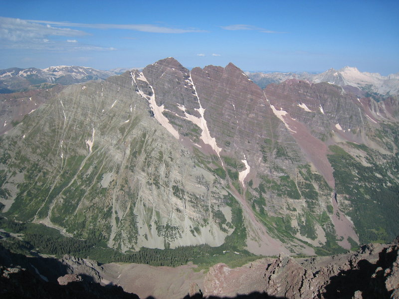 The East face of the Maroon Bells, from the summit of Pyramid Peak.  Snowmass is visible to the right in the distance.