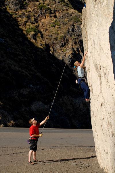 Audrey & Drew climb the offwidth (route D) at Mugu Rock.