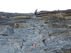Rock Climbing Photo: Breaching the summit overhang.