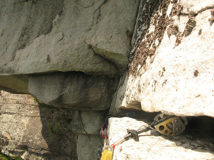 Looking back in the handcrack traverse at the top of P2.