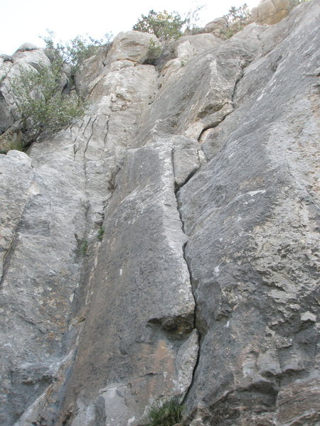 The route goes up the flake / finger crack.  You can also do the crack in the corner 3 feet left at 5.7.