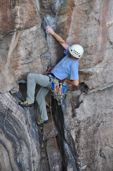 Rock Climbing Photo: Working his way out of the initial alcove.