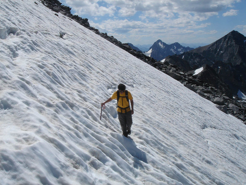 Lluis crossing the snowfield to the East Col notch.