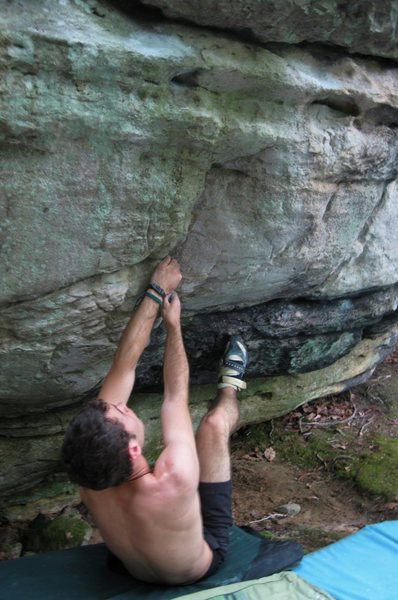 "Aaron Parlier on the start to ""Seam-Stress"" (V-Project), at the Spring Boulder, Nebo Mountain, Atkins VA"