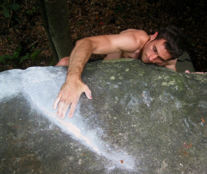 """Aaron Parlier on the seam used to top out """"Seam-Stress"""" (v4) on the Spring Boulder, Nebo Mountain, Atkins VA"""