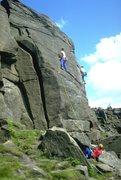 Rock Climbing Photo: A climber commits to the crux on Pot Black.