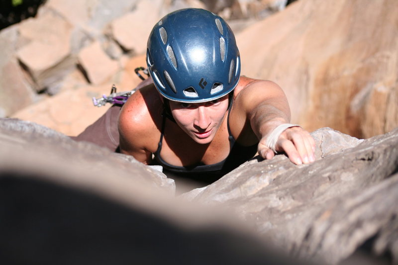Jess topping out on Loose Lips after leading it with her boyfriend Chris Tatum belaying