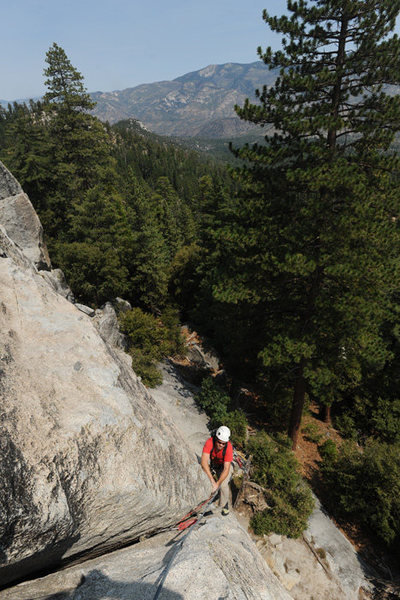 Jesse Groves negotiates a wide section near the top of the first pitch of Left Crack (5.8), Dome Rock.
