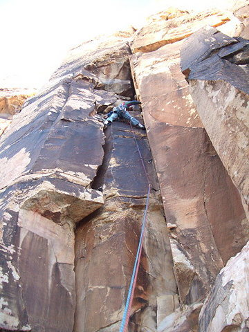 Oooooooooh! That's Andy on Whoosh at the mouth of Oak Creek Canyon in the Red Rocks, Las Vegas. This is a terrible place to belay or hang out at the crag. A giant loose block is teetering ready to fall from the top of this pitch. PLEASE share this WARNING as widely as possible.