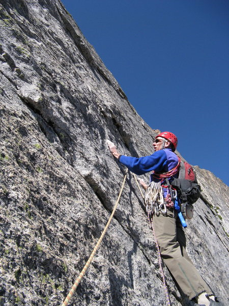 """Ross pulls down on the """"jug"""" on the crux on pitch 3."""