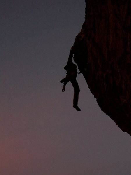 Rock Climbing Photo: Veaz swinging from the final hold on a twilight se...