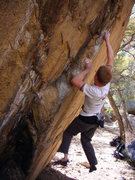 Rock Climbing Photo: Campusing a crimp and pinch during the middle crux...