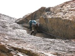 Rock Climbing Photo: Climbing on the crux pitch of Open Book in the tet...