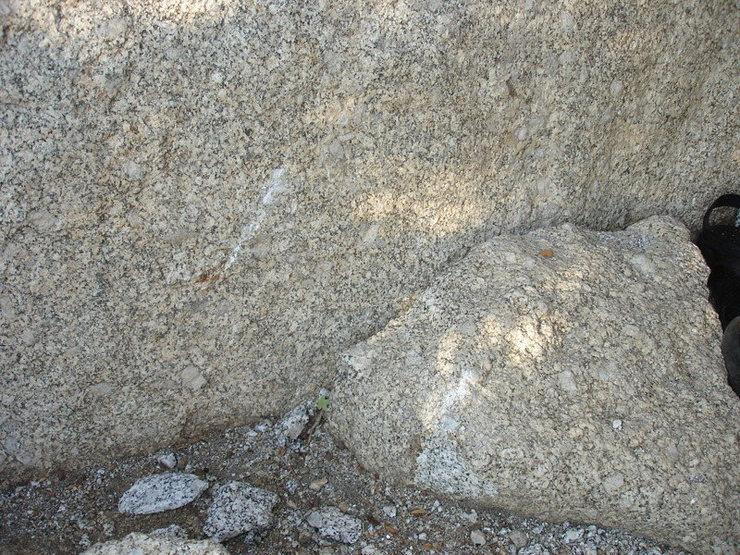 Fresh rockfall scar at base.
