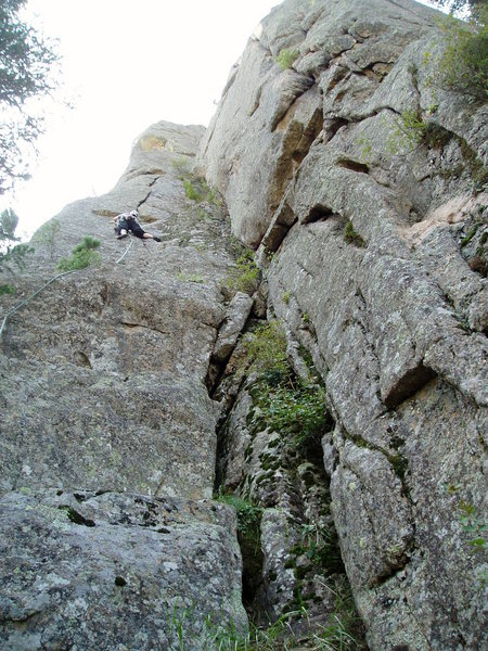 Hollow Man climbs the crack/flake and arete above on the left of the mossy dihedral. Vrainavore 10a is the crack system on the right. Handcrack-a-rete is just out of sight on the right side of the photo.