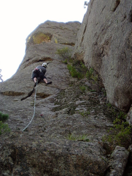 """Approaching the """"hollow"""" part. There are anchors just to the right of Chuck that can be used to descend or to belay for Planetary Pull 5.8. Was the whole wall originally as mossy as the corner?"""