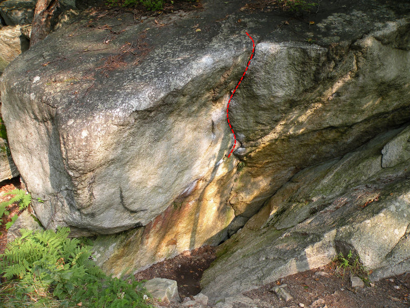 Start with your hands on the two chalky holds in the horizontal and climb up the vertical crack and face to the top out