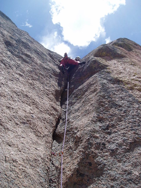 At the final hard moves of the P4 crux crack. You really have to milk the (only) several rests on this pitch. I did not successfully do that on this attempt.<br> <br> Photo by Paul Rezucha.