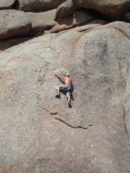 This is a climb we did in the East L.A. climbing area in Vedauwoo, WY.  I am not sure what it is rated but the feet and hands were very thin. Sweet climb!