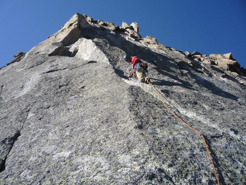 Starting the crux pitch.