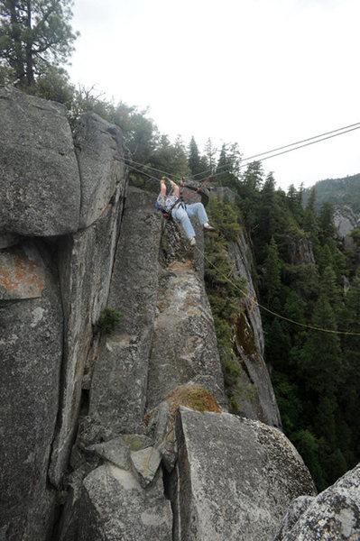 Rock Climbing Photo: David Hoffberg uses a tyrolean traverse to get bac...