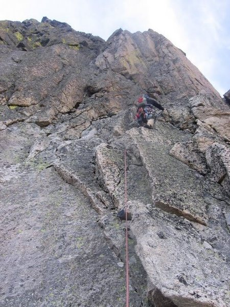 Going up first pitch of the steep wall.