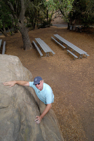 Michael McKay traverses the Barbeque Boulder, Skofield Park.