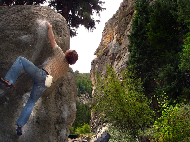 """Luke Childers slapping his way up the """"Standard Bulge"""" on the """"Castle Rock Cube"""" A.K.A. the """"Citadel Boulder"""" near the """"Castle Rock"""" formation.  Boulder Canyon, Colorado."""