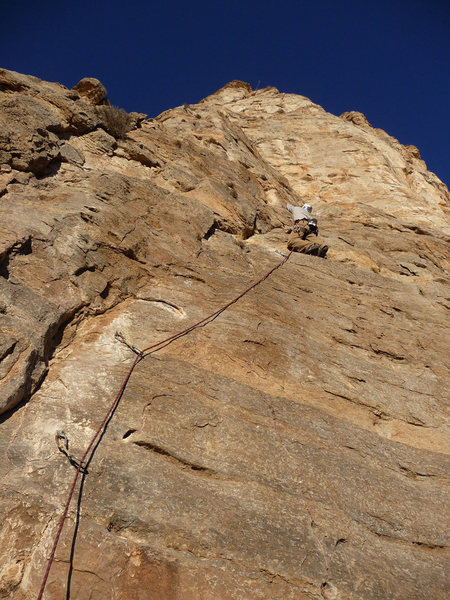On the FA of the first pitch on what is probably the easiest route thus far (5.7 or 5.9) at The Bat Cave.  Once things cool off this line will continue to the top of this cliff.