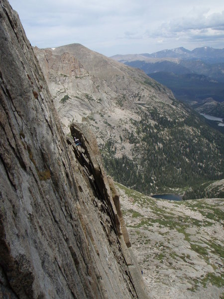 Looking at the crux pitch of the Ten Essentials as viewed from Syke's Sickle.  Lots of fun stemming behind the flake. Photo by Seth Dee.