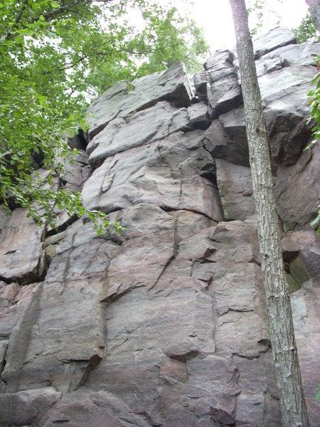 """Moon Beam"" climbs the face between the cracks."