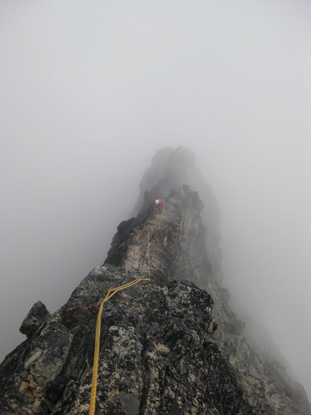 Britta climbing through dramatic fog