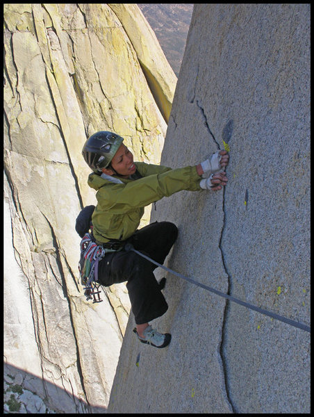 Angelina hand traversing on the thin flake near the end of Lost At Sea in The Needles.