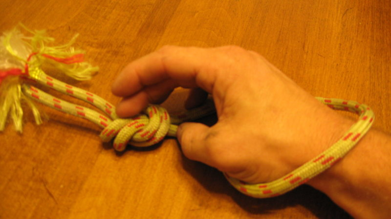 Starting with an overhand on a bight.  My middle finger is on the two strands that you work with next.<br> <br> Photos posted for [[this thread.]]http://www.mountainproject.com/v/general_climbing/anyone_ever_use_the_equalizing_2loop_eight_in_anchors/106529725@POUND@a_106531056