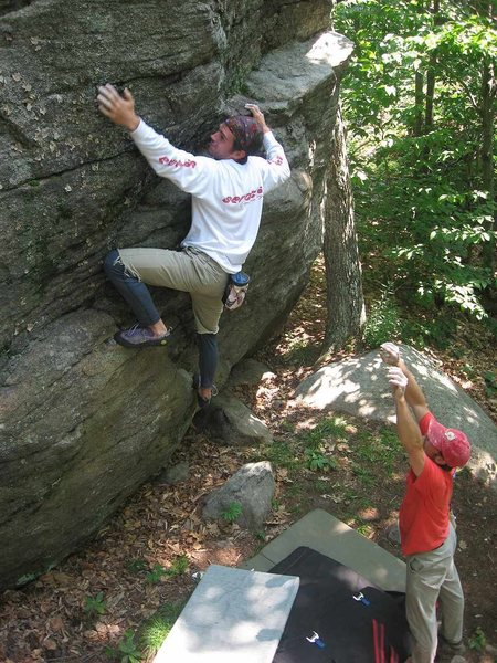 Justin Barrett strains for a hold on Spy-Hopping, a V3 on the Moby Rising Boulder.